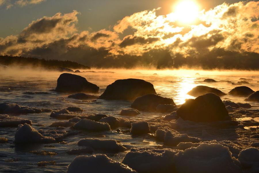 Sea is freezing finally in baltic sea, temperature - 20 C. Baltic Sea Beach Beauty In Nature Cloud - Sky Finland Freezing Cold FreezingMyAssOff Freezingweather Nature No People Outdoors Rock - Object Scenics Sea Sea And Sky Seafog Seasmoke Skandinavia Sky Sun Sunbeam Sunset Water Water Is Freezing Winter