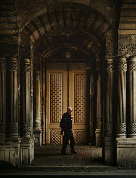 Rear View Architecture One Person Arts Culture And Entertainment People Built Structure light and reflection Geometric Shapes Street Life Istanbuldayasam Doorway Streetphotography Outdoors Life Geometric Architecture Building Exterior waiting game The Street Photographer - 2017 EyeEm Awards
