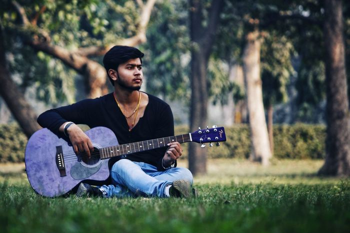 Rahul - Abshine photography Rahul Abshine Abshine_photography Canon Canon1200d Canonphotography Delhi Photography Photographyoftheday Picoftheday DSLR Camera Guitar Music Plucking An Instrument Arts Culture And Entertainment Musician Sitting Singing Playing Full Length Relaxation