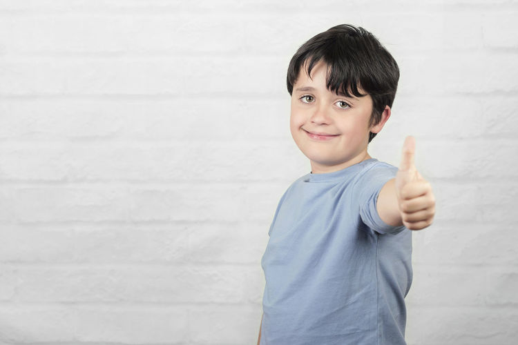 Portrait Child Smiling Happiness Thumbs Up Finger Thumbs Positive Emotion Positive Positivity Happy Happiness Success Fun Funny Lifestyle People Smile Ok Expression Communication Motivation Winner Idea Emotion