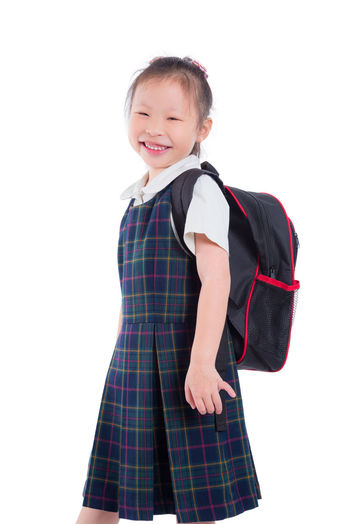 School Girl Isolated Backpack Uniform White Kid Little Background Child Education Portrait Kids Cute SchoolGirl Happy Smile Student Beautiful One Youth Schoolbag Bag Female person Pupil Pretty Study Preschool Childhood Standing Learn Knowledge Holding Young Studying Asian  Chinese Korean Thai