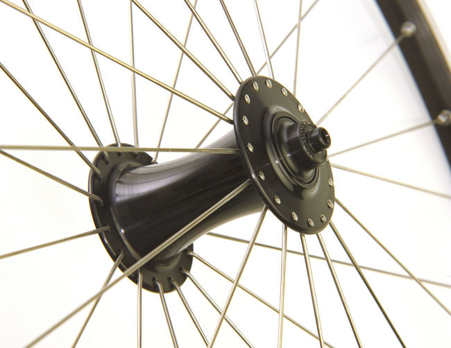 Black Bicycle Hub with radial spokes and black rim in perspective view Bicycle Hub Bicycle Spokes Bicycle Wheel Close-up Indoors  No People