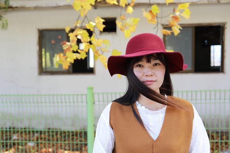 Portrait of girl wearing hat standing outdoors