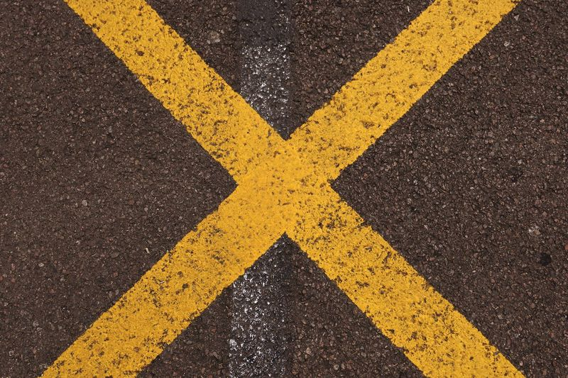 Backgrounds Yellow Road Marking Asphalt Road Street No People Textured  Outdoors Road Sign Paint The Town Yellow