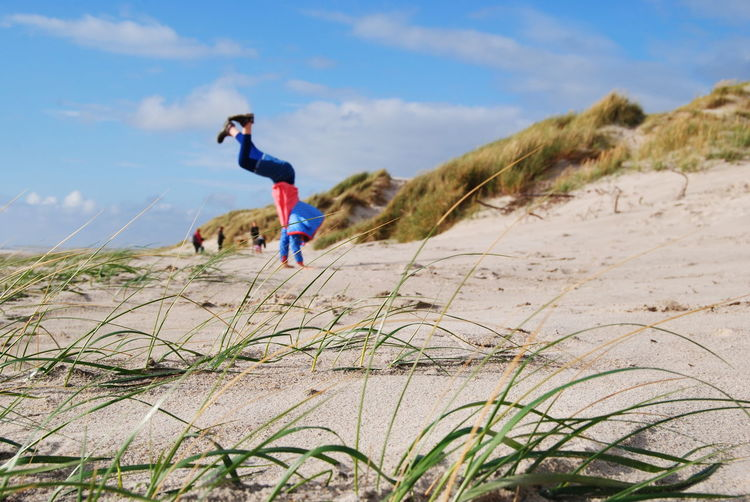 EyeEm Best Shots Leisure Activity Newoneyeem Eye4photography  Sunlight Outdoors Healthy Lifestyle Vitality Day Sky Sports Clothing Activity Denmark Beach Beach Life Upside Down Handstand  Youth Sport Sand