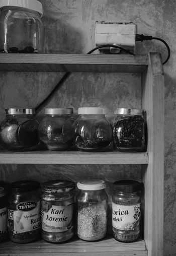 Bottles on shelf in kitchen