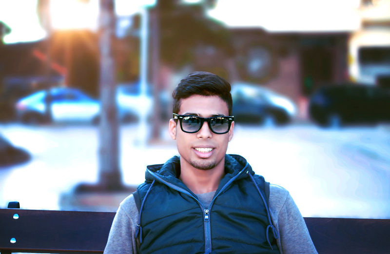 Portrait One Person Glasses Young Adult Real People Young Men Front View Lifestyles Focus On Foreground Looking At Camera Leisure Activity Fashion Smiling Casual Clothing Architecture Sunglasses Headshot Happiness Handsome Outdoors Warm Clothing Fashion Fashion Photography Fashion Model