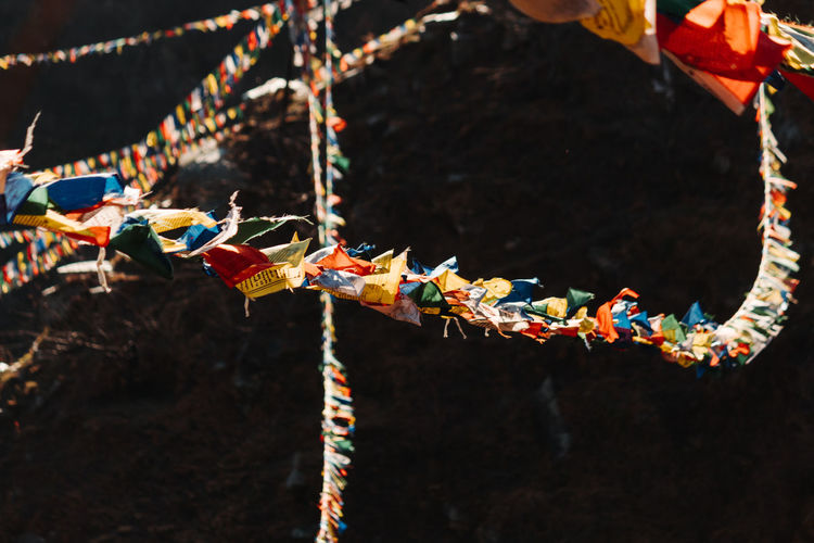 Close-up of multi colored tied hanging on rope