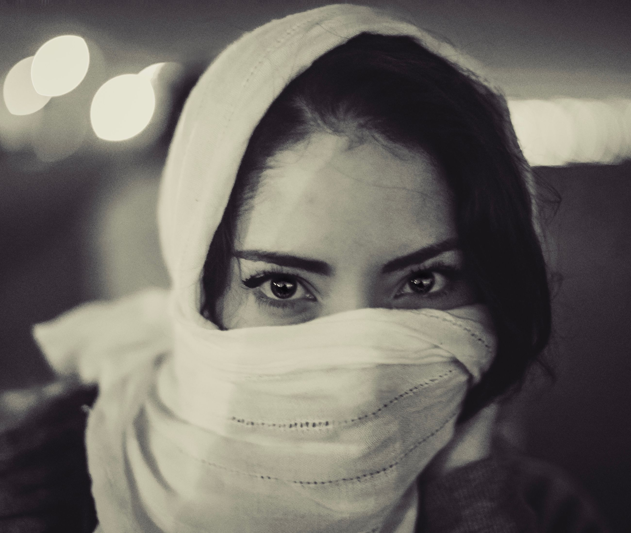 CLOSE-UP PORTRAIT OF A YOUNG WOMAN COVERING FACE WITH HAIR