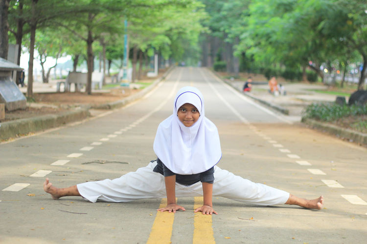 Portrait Of Girl In Traditional Clothing Practicing Taekwondo On Road