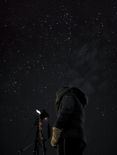 Low angle view of astrophotographer