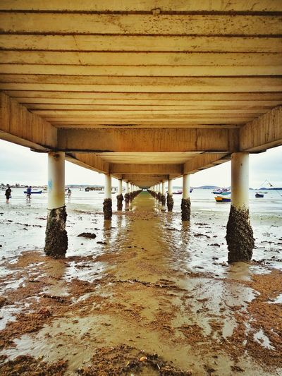 Bom dia!!! EyeEm Selects Huaweiphotography Covered Bridge Architectural Column Shore Pier Sandy Beach Hooded Beach Chair Waterfront Horizon Over Water Wave Sand Pebble Beach Ocean Boat Colonnade Calm Rushing