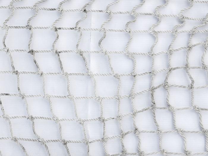 Full frame shot of net against wall