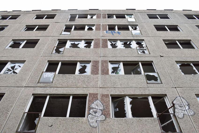 Ruined GDR-era flat facade as seen from below. Berlin Concrete DDR Desolate GDR Plattenbau Urbex Urbexexplorer Urbexphotography
