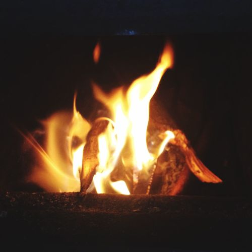 burn. Flame Fire - Natural Phenomenon Heat - Temperature Burning Night No People Close-up Cabin Oven Woodstove Fireplace Warming